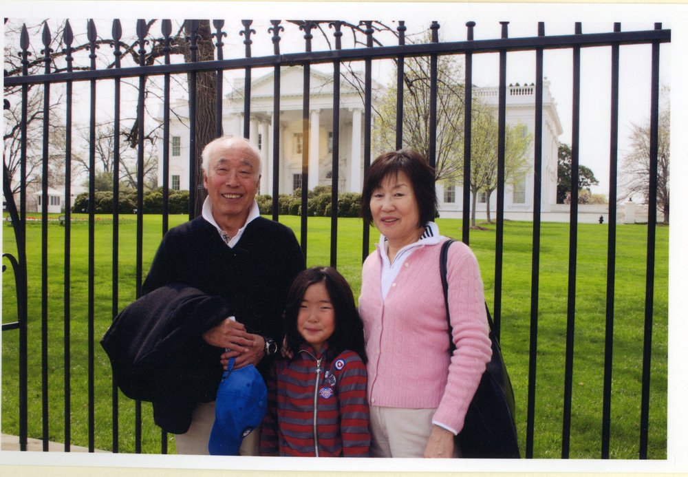 With Kook Dong Pae and their grandchild, Chloe, in Washington, D.C.