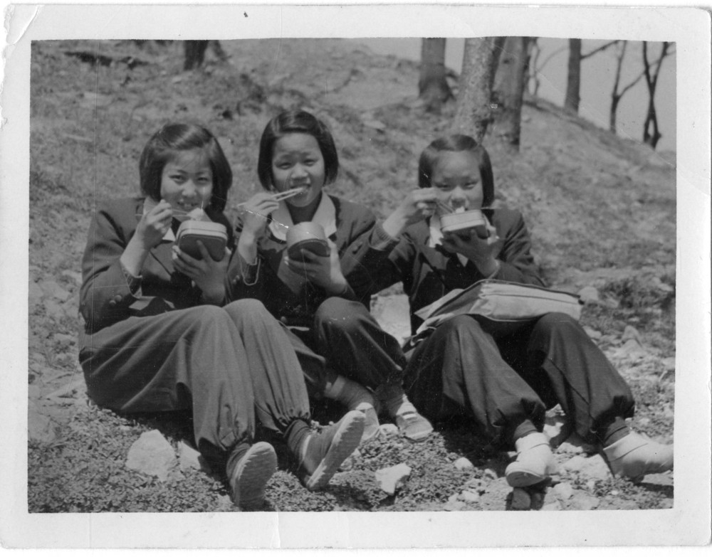 With her high school friends in Pusan during the Korean War
