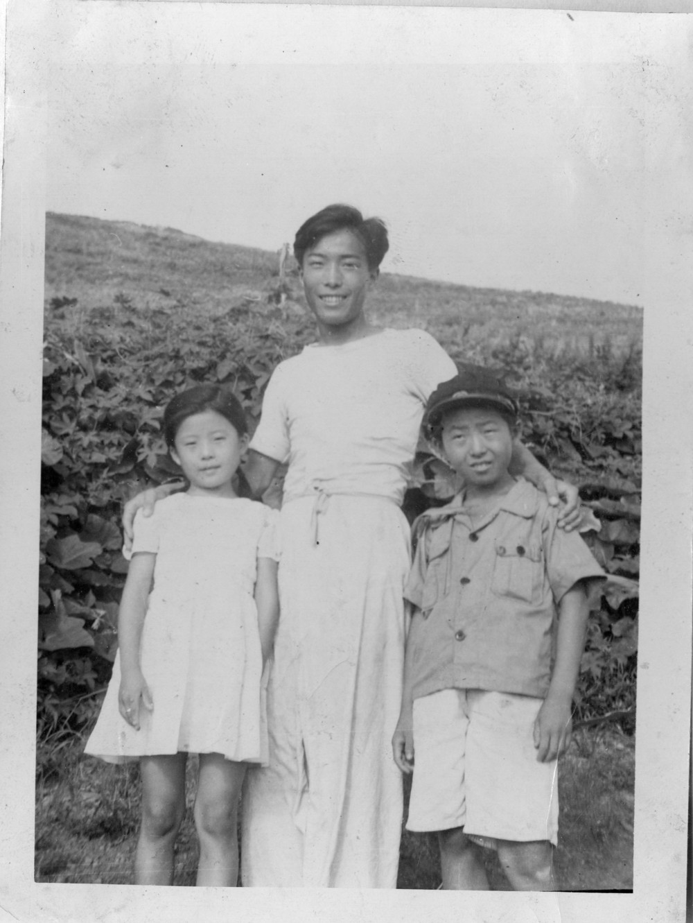 With his sister and brother, circa 1953