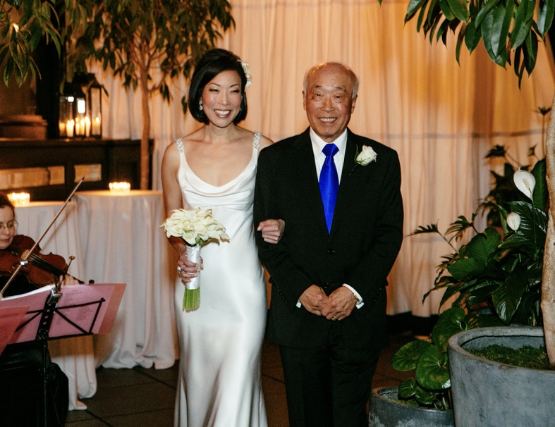 Walking his daughter down the aisle, 2013