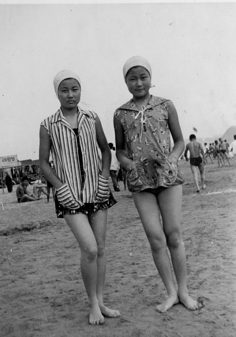 With her sister on the beach, late 1950s