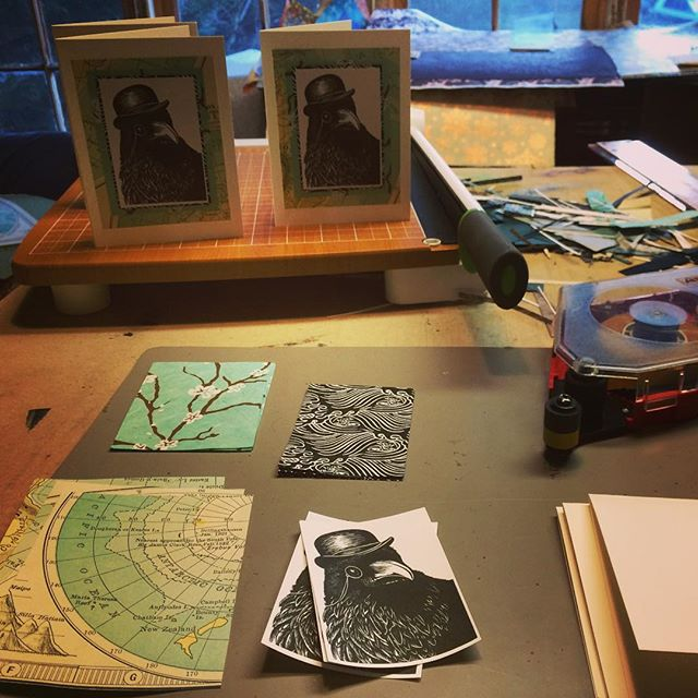 Out of chaos comes the dance of balance! Grooving on some powerful women singers #mariboine and #ulali while happily assembling cards for the marvelous #whitprintholidaysale this weekend 12/7-9. #studiolife #linocut #linoprint #nopapercuts #whitprint