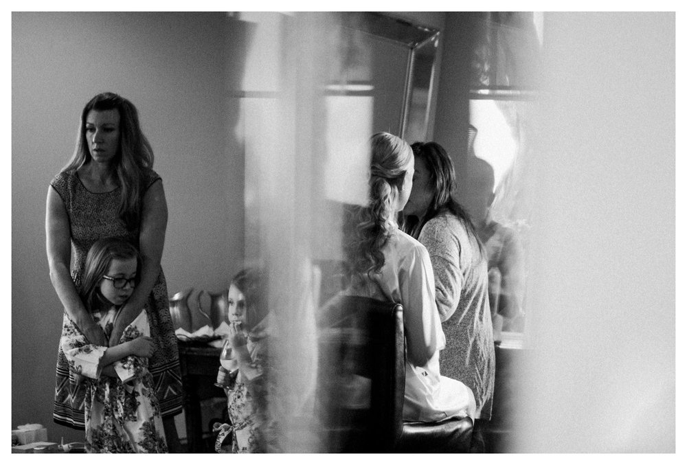 A candid wedding photo of a brides reflection