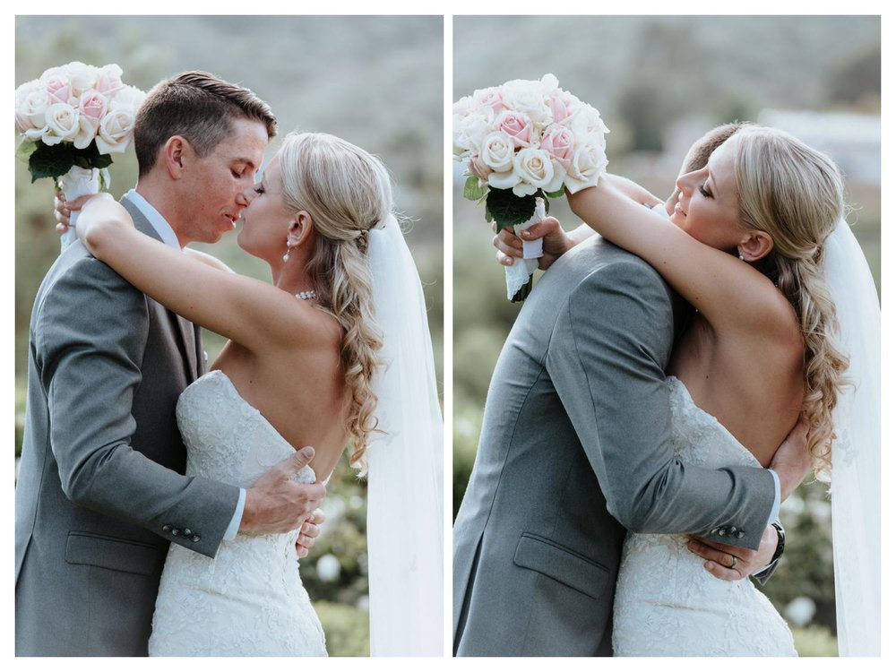 Newlyweds have an emotional embrace during their wedding ceremony.