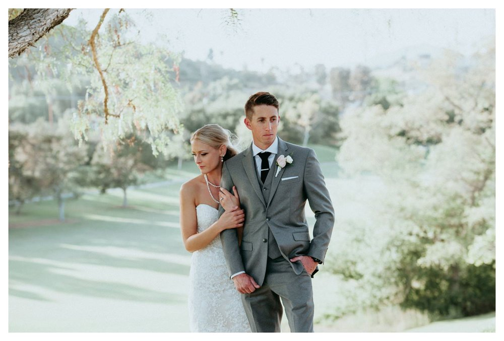 A stylish wedding couple pose for their wedding photos in San Marcos, CA.