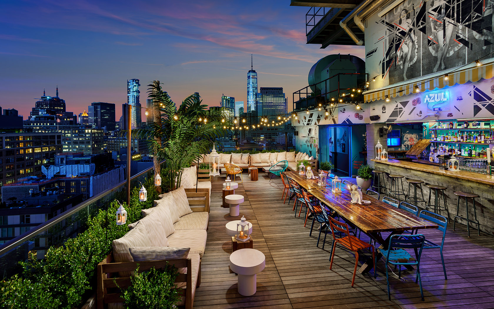 Azul on the Rooftop at Hotel Hugo, NYC puts a new spin on swanky outdoor living.  With a solid view of Manhattan's skyline, some funky art, colorful and eclectic furniture, it should be obvious while this spot is the cat's pajamas!