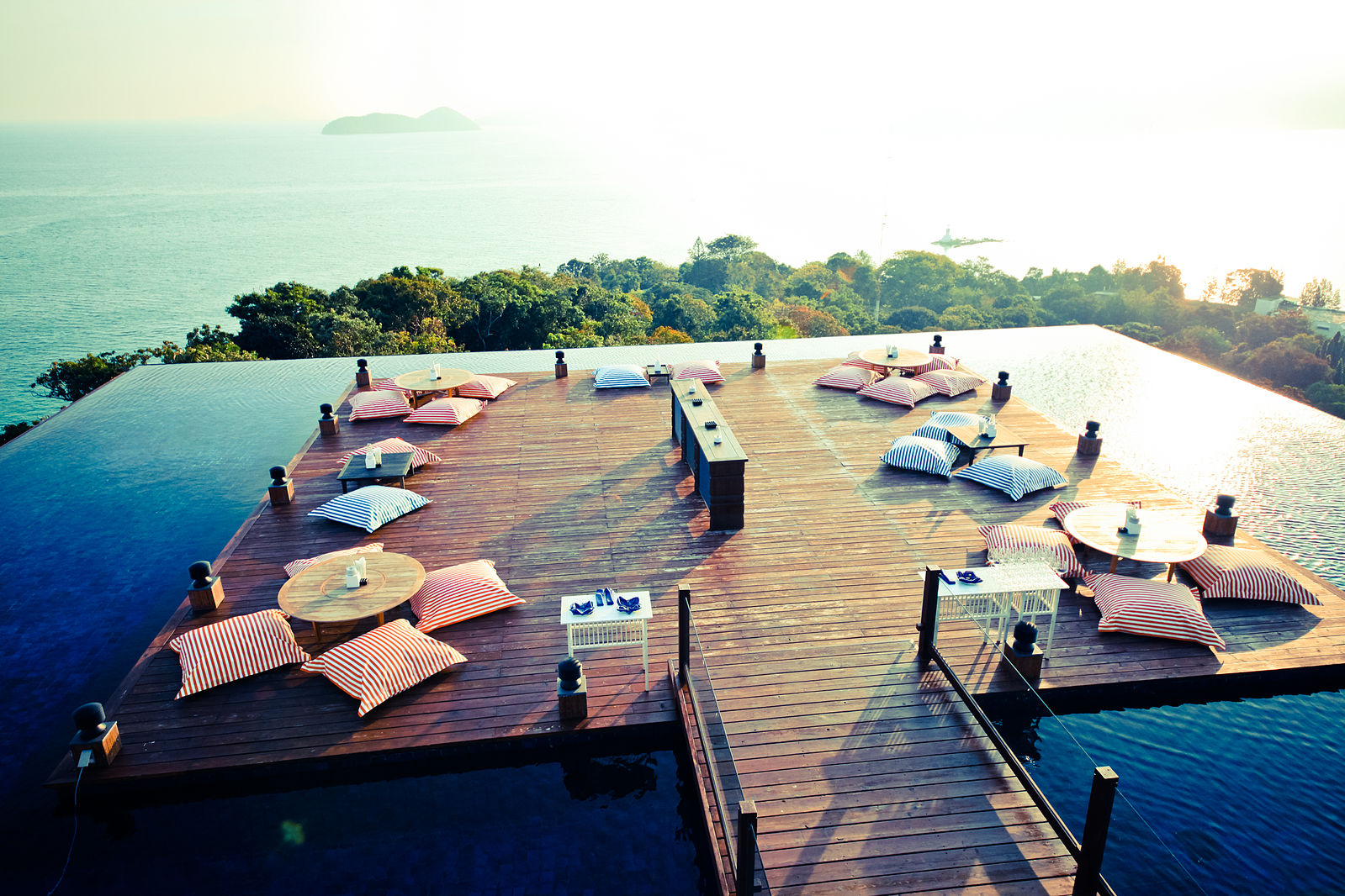 Baba Nest at Sri Panwa Resort, Phuket, Thailand features a floating deck that overlooks the Andaman Sea with low tables and pillow-type seats perfect for lounging around and watching the sun set.