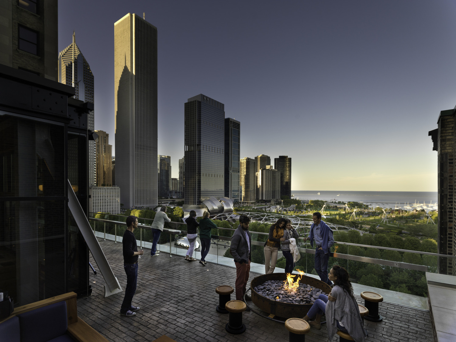 Cindy's Rooftop Bar & Terrace at The Chicago Athletic Association in Chicago offers spectacular views of Millennium Park and Lake Michigan. The Large Drum Fire-pits certainly don't hurt either.
