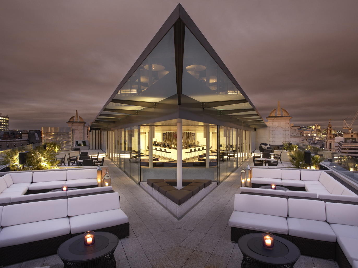 A very symmetrical Radio Rooftop Bar in London offers a stylish and contemporary alternative to the all-so-common dimly light pubs that are scattered across the city, perfect for a night of celebration.