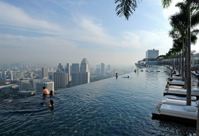 The infinity pool that runs the length of the Roof Deck of SkyPark at Marina Bay Sands Hotel, Singapore will take your breath away and might in turn give you vertigo.