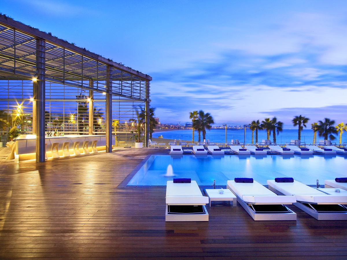 Wet Deck at the W Barcelona.  This pool deck, with it's cool indoor/outdoor structure, pure white lounge chairs, and an unobstructed view of the water (palm trees galore) this is where you want to recharge...
