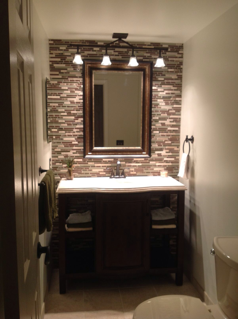 Tile accent wall behind sink from  Houzz