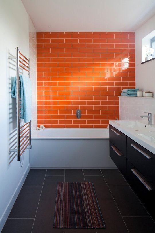 Orange bathtub accent wall from  Apartment Therapy