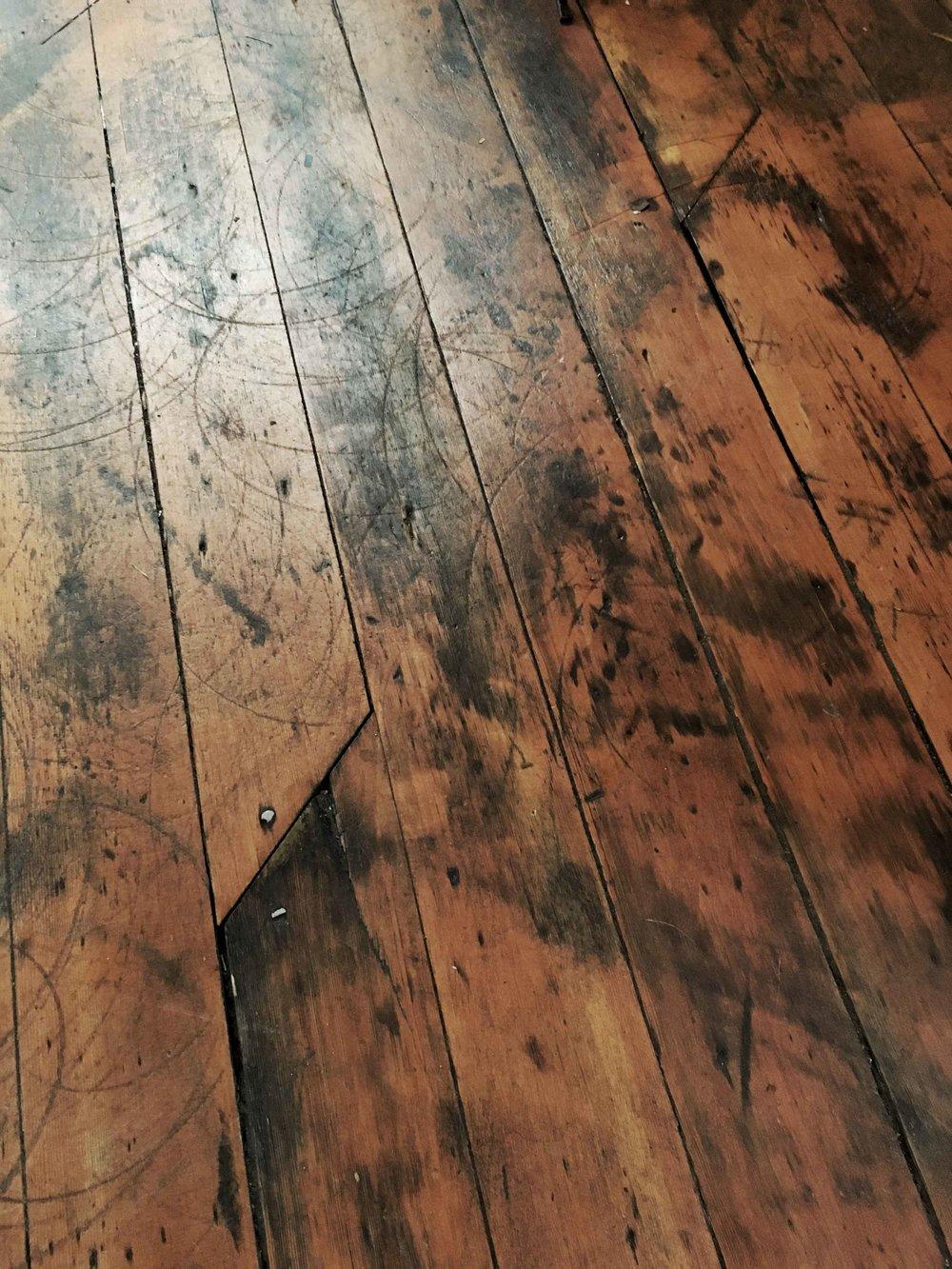 Scratched up hardwood floors
