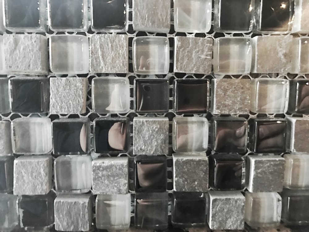 dark painted glass mosaic backsplash divine hardwood and stone in Portland, OR