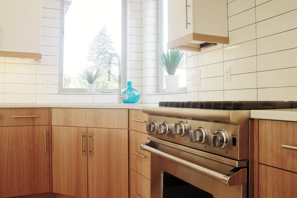 subway tile kitchen backsplash by Divine Hardwood & Stone in Portland, OR