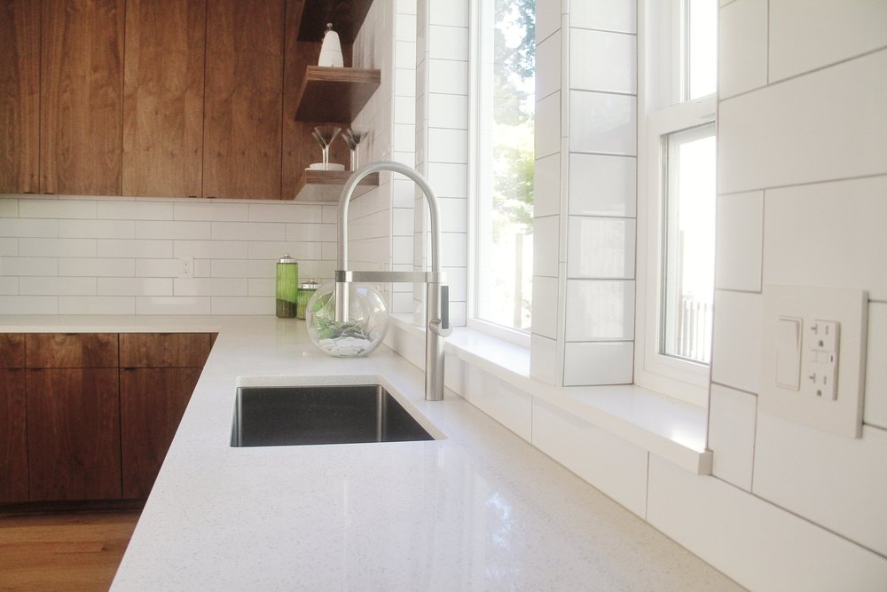 subway tile backsplash in kitchen by divine hardwood and stone in Portland, OR