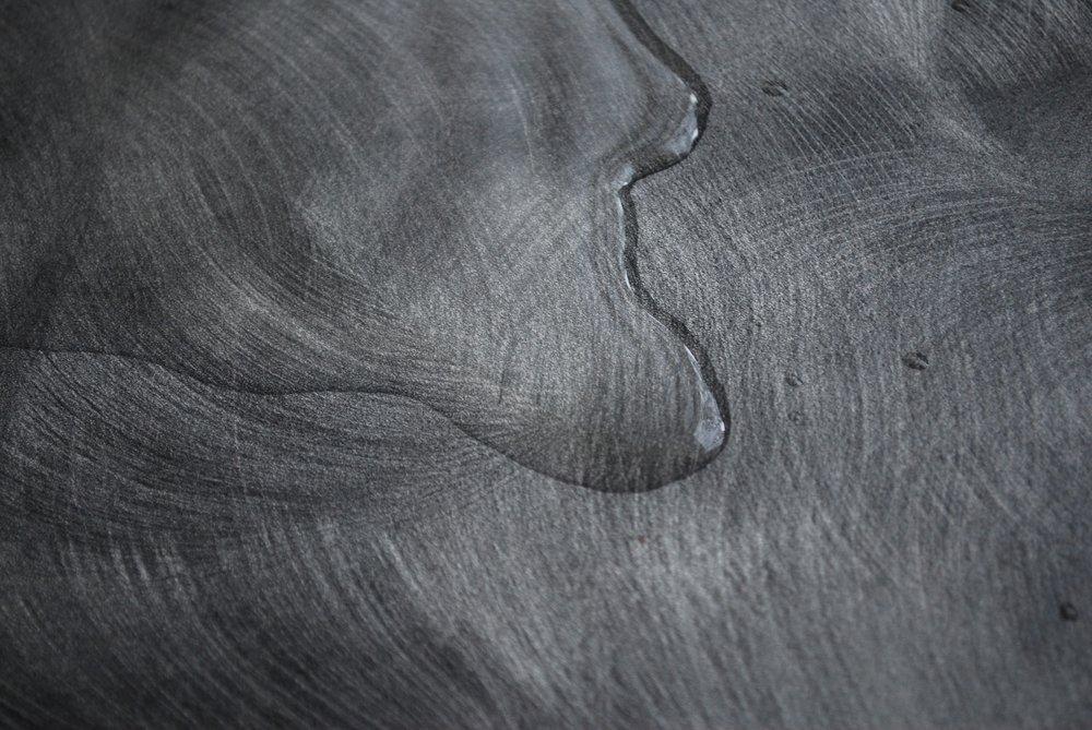 clean up liquid spills on hardwood immediately