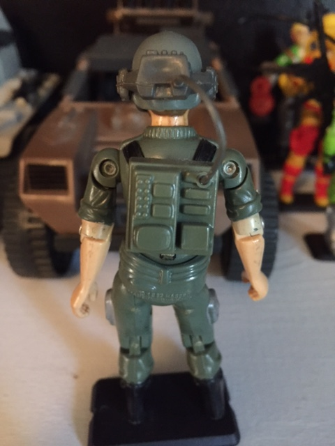 Breakers head set and microphone plug into the radio backpack which attaches to the peg hole on his back.