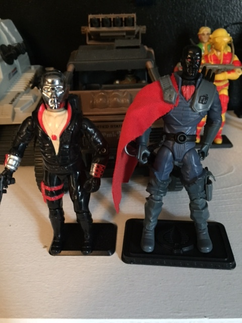 1983 Destro beside a circa 25th Anniversary Destro figure.  I really hate the black mask destro and I'm not sure why he's in my collection.  i think he came in a multi-pack or something.