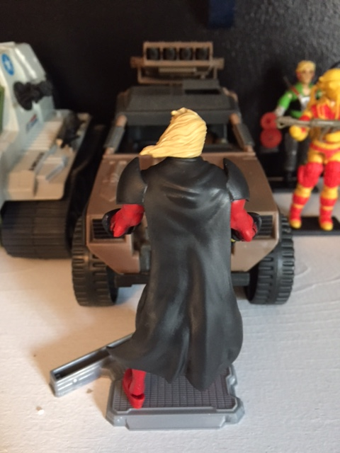 the hair looks even worse from behind.  the cape is molded close into the body so at least he stands up ok on an action figure stand unlike so many of the marvel UNIVERSE / marvel legends figures.