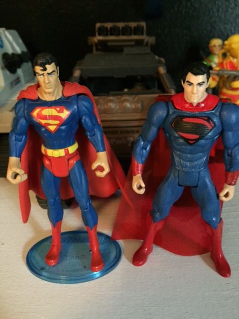 Superman side by side with a newer Superman: Man of Steel figure which is terrible. I do wish i could swap out the hands but that is absolutely the only thing better about the more recent superman figures.