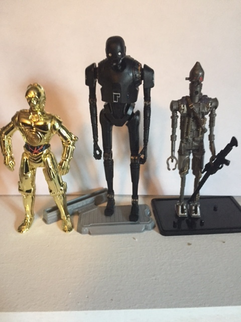 K-2SO stands considerably taller than most other star wars 3.75 inch action figures.  here he is shown with the similarly constructed IG-88