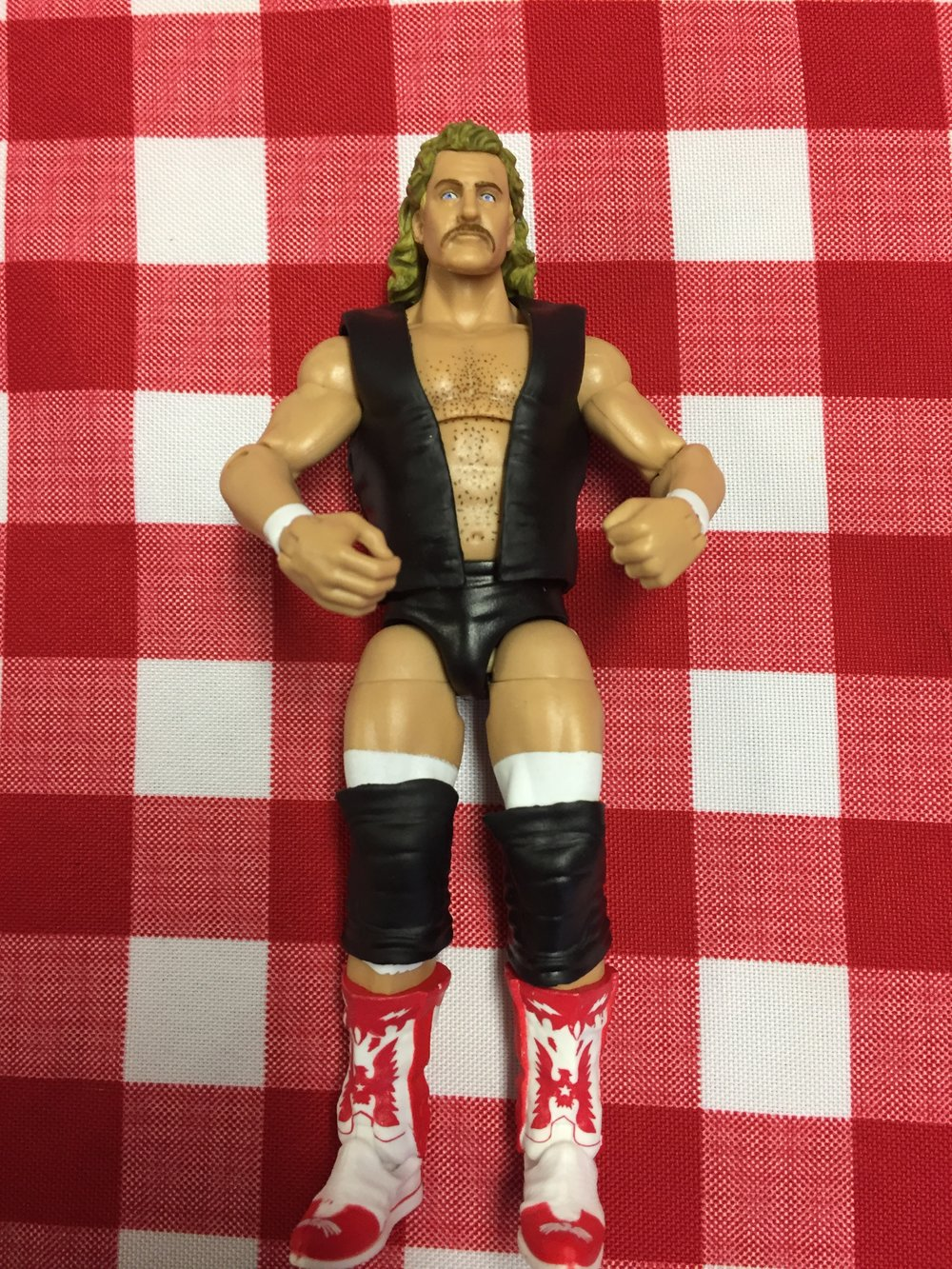 Magnum T.A. has a great head and face sculpt and comes with a removeable vest.