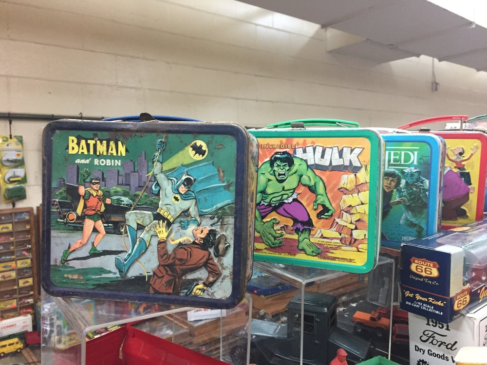 I believe all of these lunchboxes are circa 1980s.  this booth had lots of antique cars and hotwheels too.