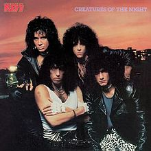 the album was re-released in 1985 without the make-up and low and behold guitarist vinnie vincent still didn't make the cover.  this time bruce kulick did.