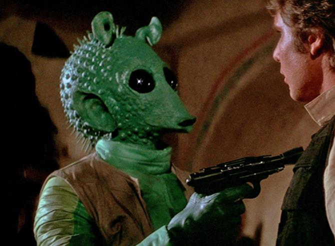 Greedo was one of the more memorable aliens in star Wars: A new hope.  Greedo was a bounty hunter confronting han solo in the iconic Cantina scene... and yes han shot first.