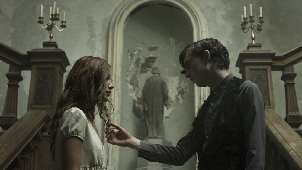 The Lodgers 03 - Charlotte Vega as Rachel - Bill Milner as Edward.jpg