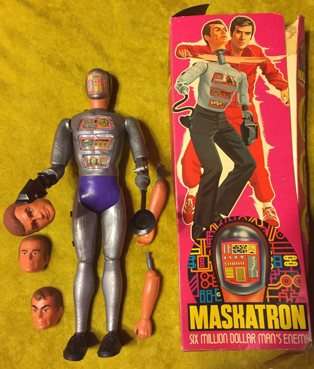 The maskatron figure was a grey metal color that came with 3 faces (steve austin, Oscar Goldman, & maskatron human), two human arms, a suction cup arm, a claw arm, removeable shoes, pants, and shirt.  (mine is missing only the pants.)