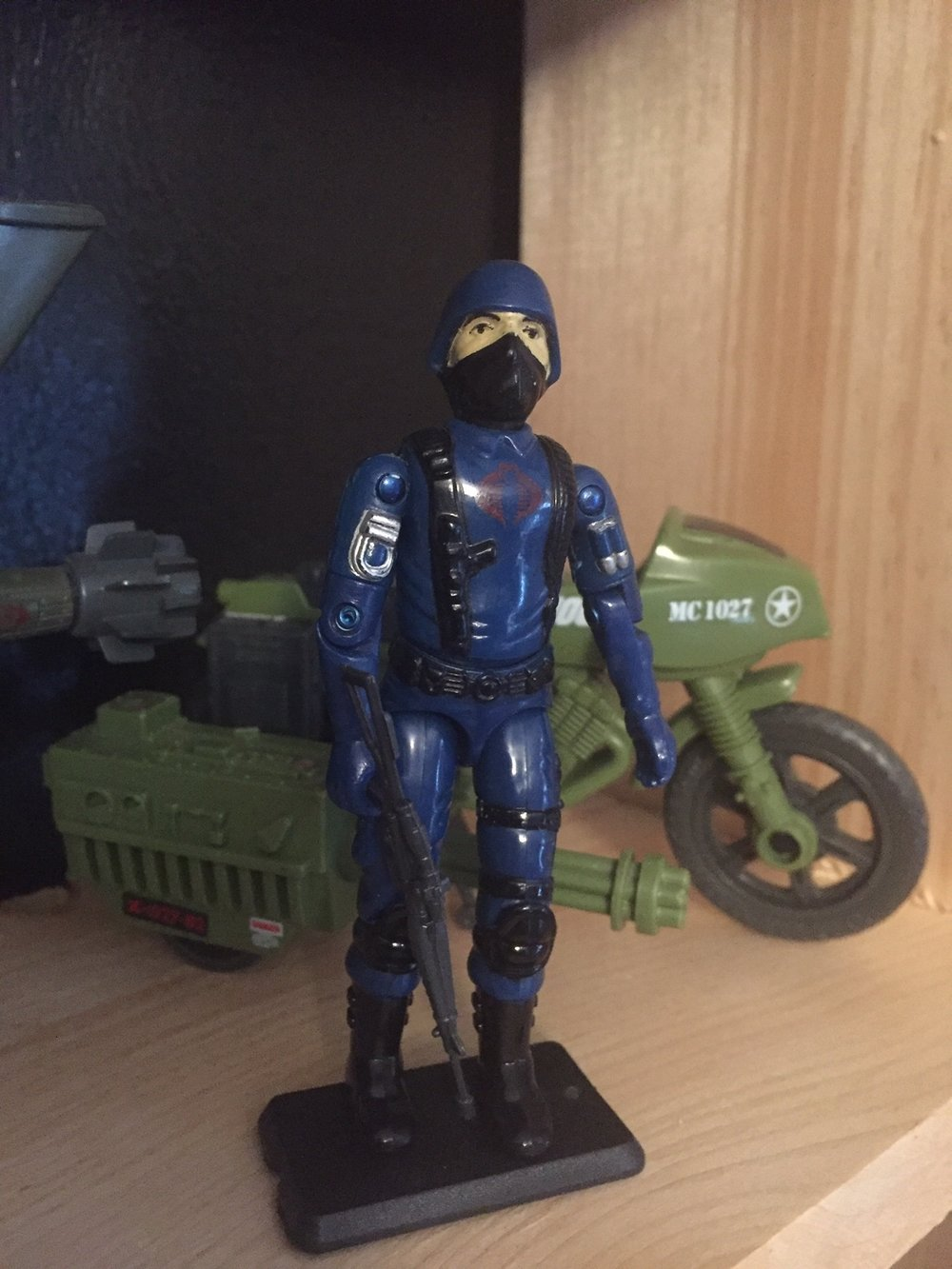 G.I. Joe Cobra The Enemy (1983) (Swivel Arm Battle Grip) from the when it was cool collection with RAM Motorcycle in the background.