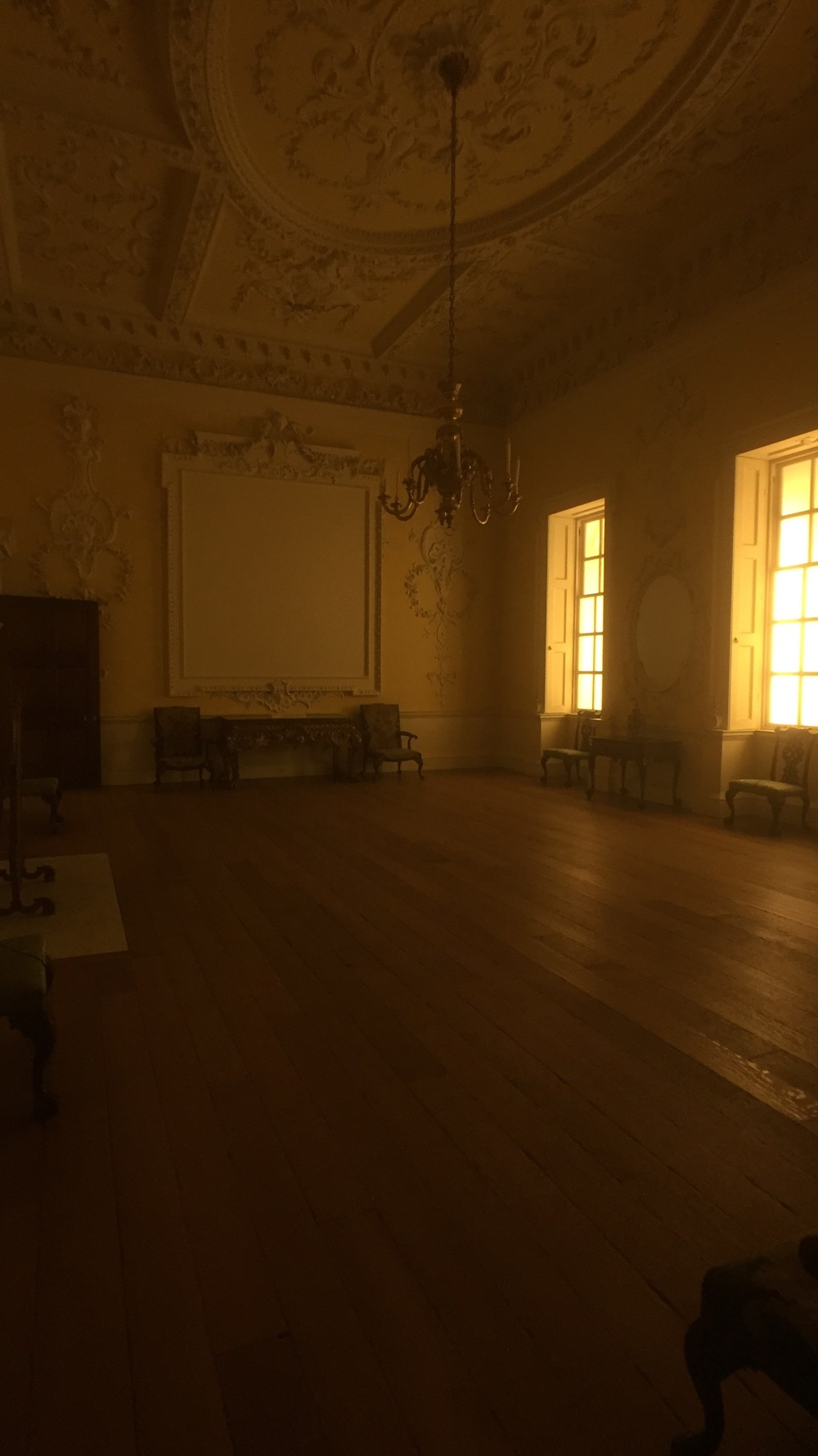 A late 18th century dining room on the upper floors of the European Sculpture and Decorative Arts Wing is amber lit in the morning light
