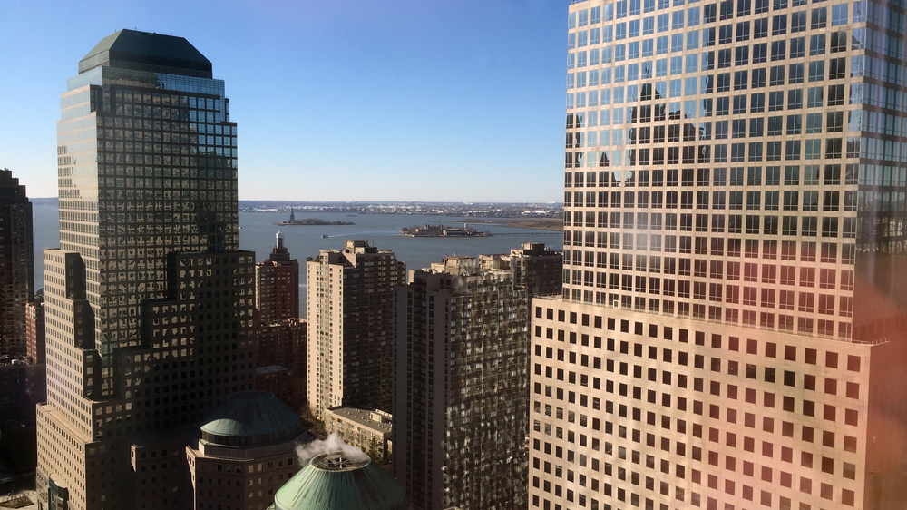 Looking towards Liberty and Ellis Islands from the 35th floor of One World Trade Center on a sunny morning - January 4, 2016