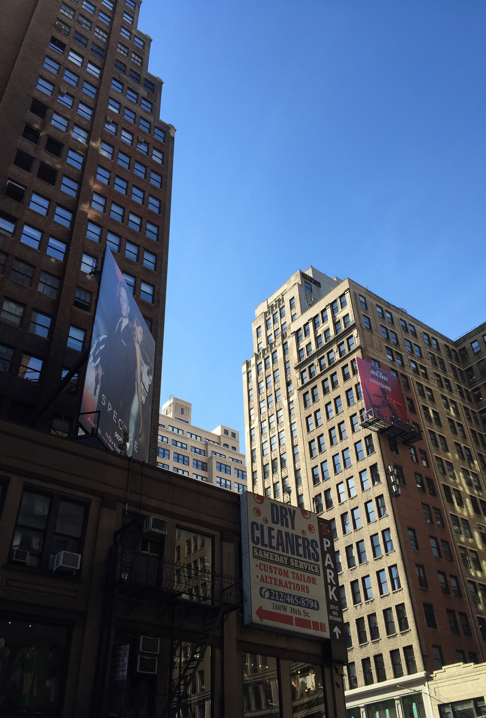 Looking up at the skyscrapers on the corner of West 30th street and 7th avenue  on a sunny autumn afternoon - November 9, 2015