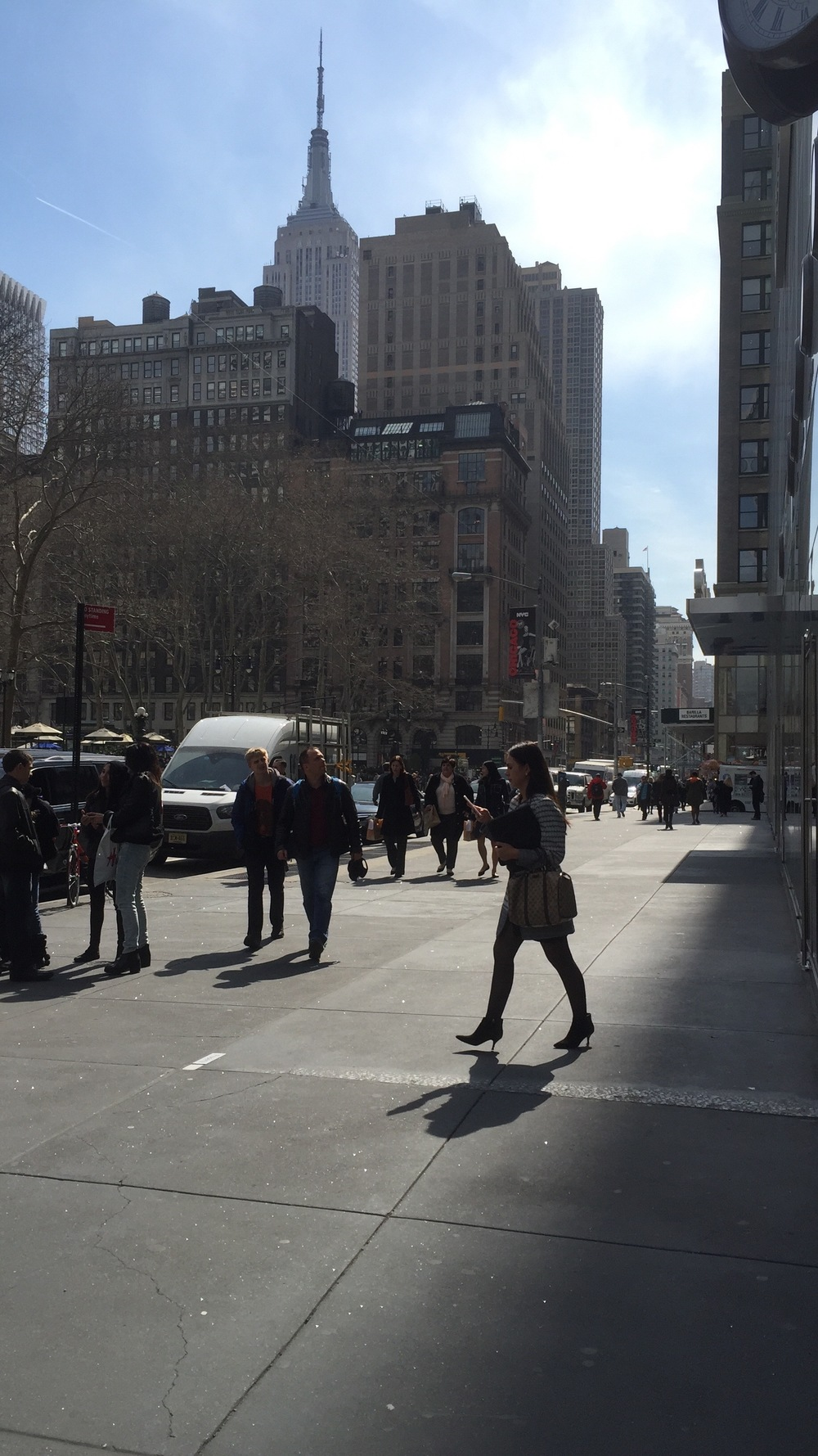 Looking south, towards the Empire State Building across from Bryant Park on 42nd Street and 5th avenue on a sunny Spring afternoon - March 23, 2016
