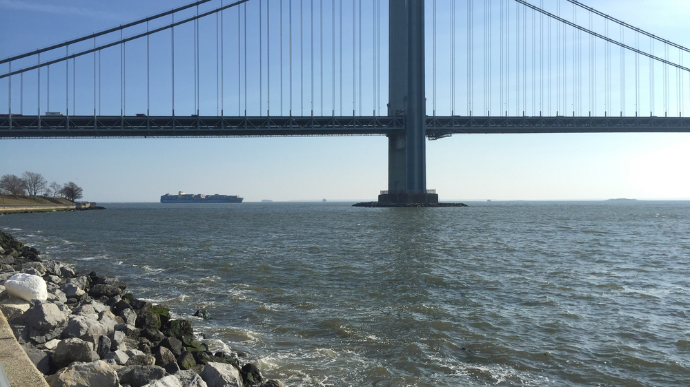 Various boats coming in and leaving from New York Harbor pass under the Verazzano-Narrows Bridge - March 7, 2016