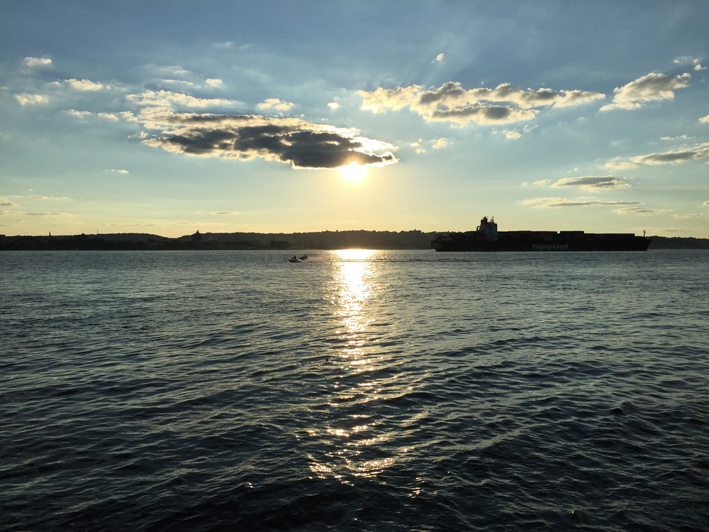 A Summer's setting sun on The Narrows being blocked by a passing cloud - August 28, 2015