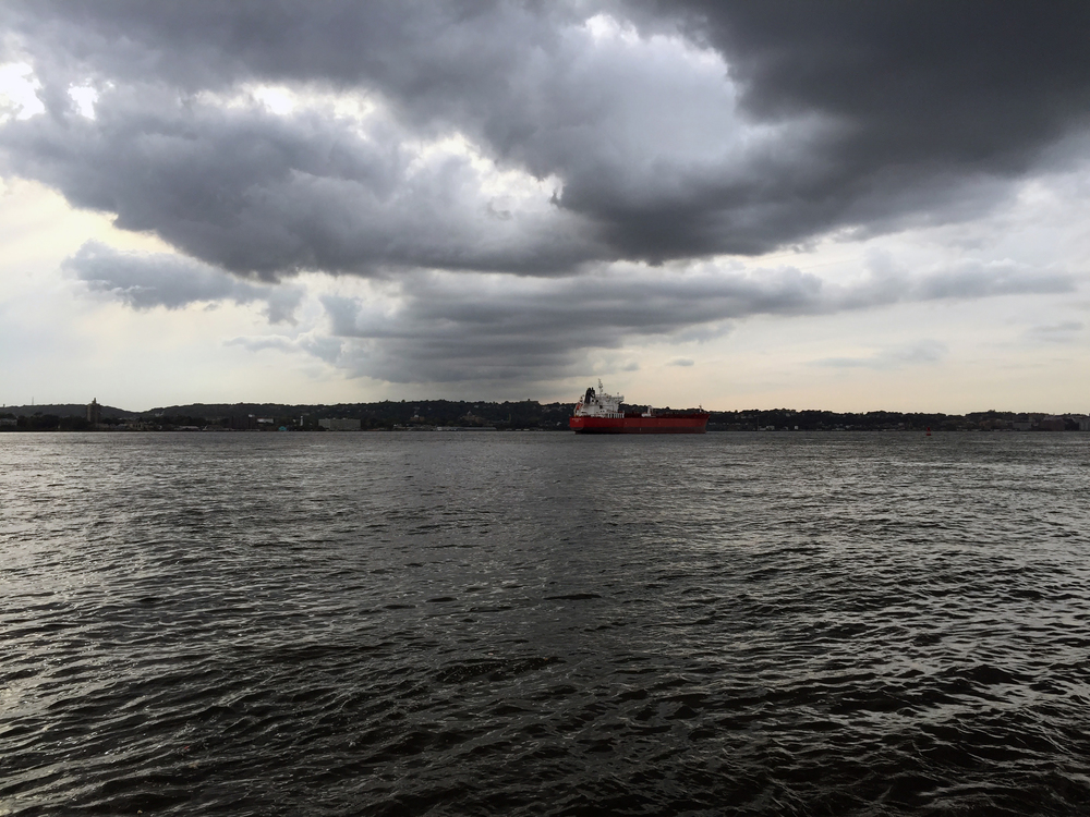 Storm clouds hang low over a ship on the Narrows - September 25, 2015