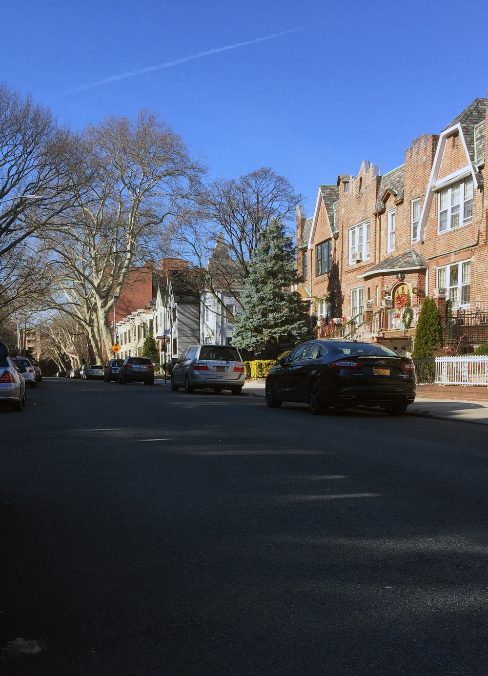 Looking west on 92nd Street towards Marine Avenue on a sunny last day of autumn - December 20, 2015