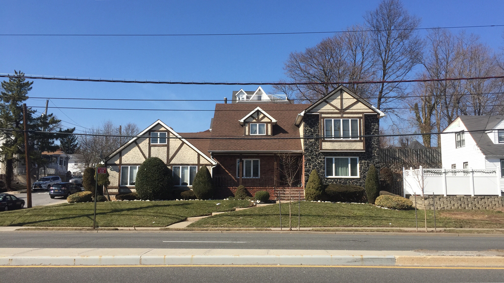 Looking towards an attractive house on the corner of Hylan Boulevard and Whitman Avenue early in the afternoon on a warm first day of March - March 1, 2016