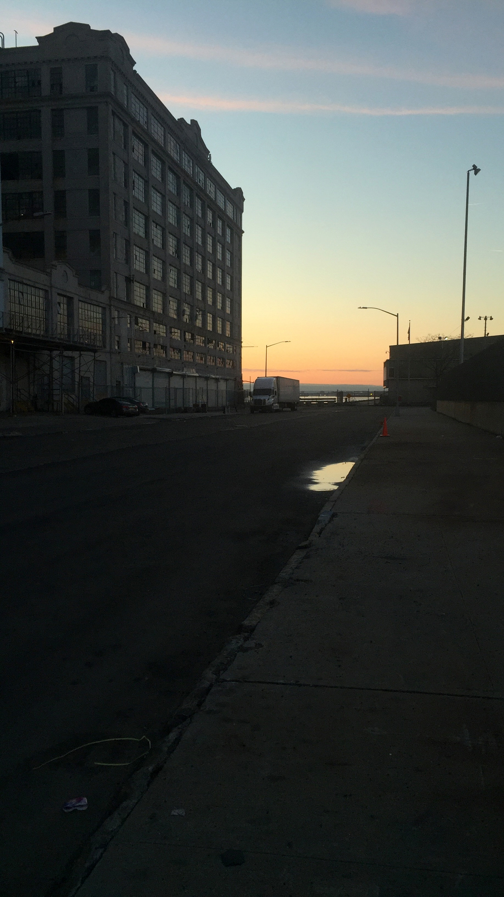 Looking towards an abandoned factory building along the Upper New York Bay waterfront in one of the last remaining industrial sections of Brooklyn on 39th Street during sunset - March 15, 2016
