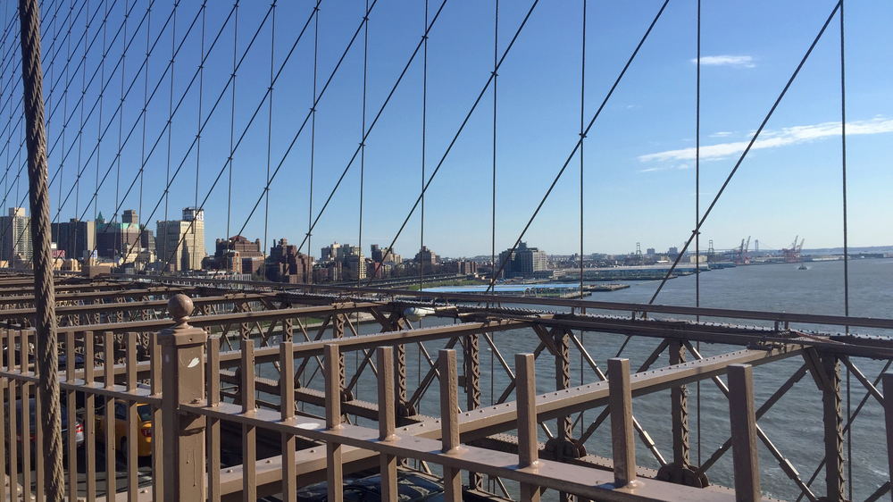 Looking towards DUMBO in Brooklyn, from the Brooklyn Bridge on a sunny April day - April 10, 2016
