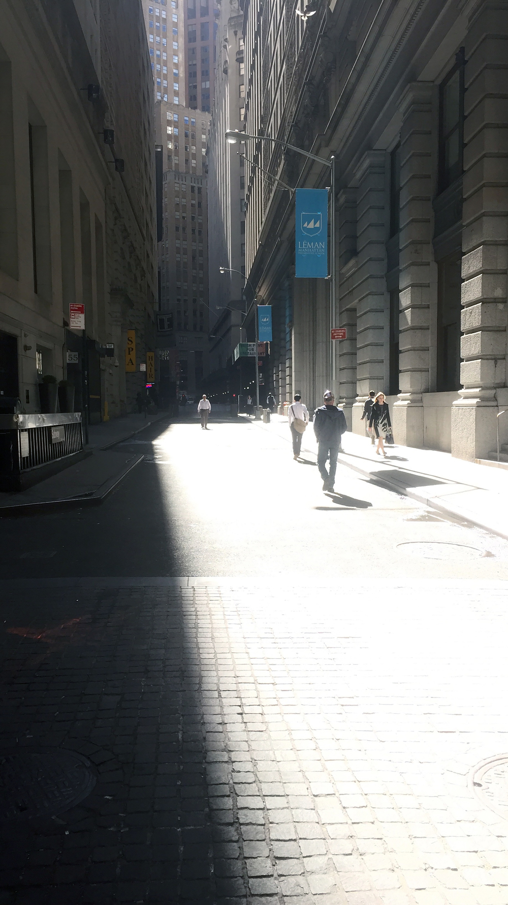 Looking east on Exchange Place towards William Street on a sunny morning - April 20, 2016