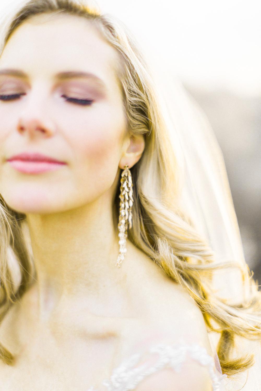 Detailed shot of bride's earrings in Santa Fe.jpg