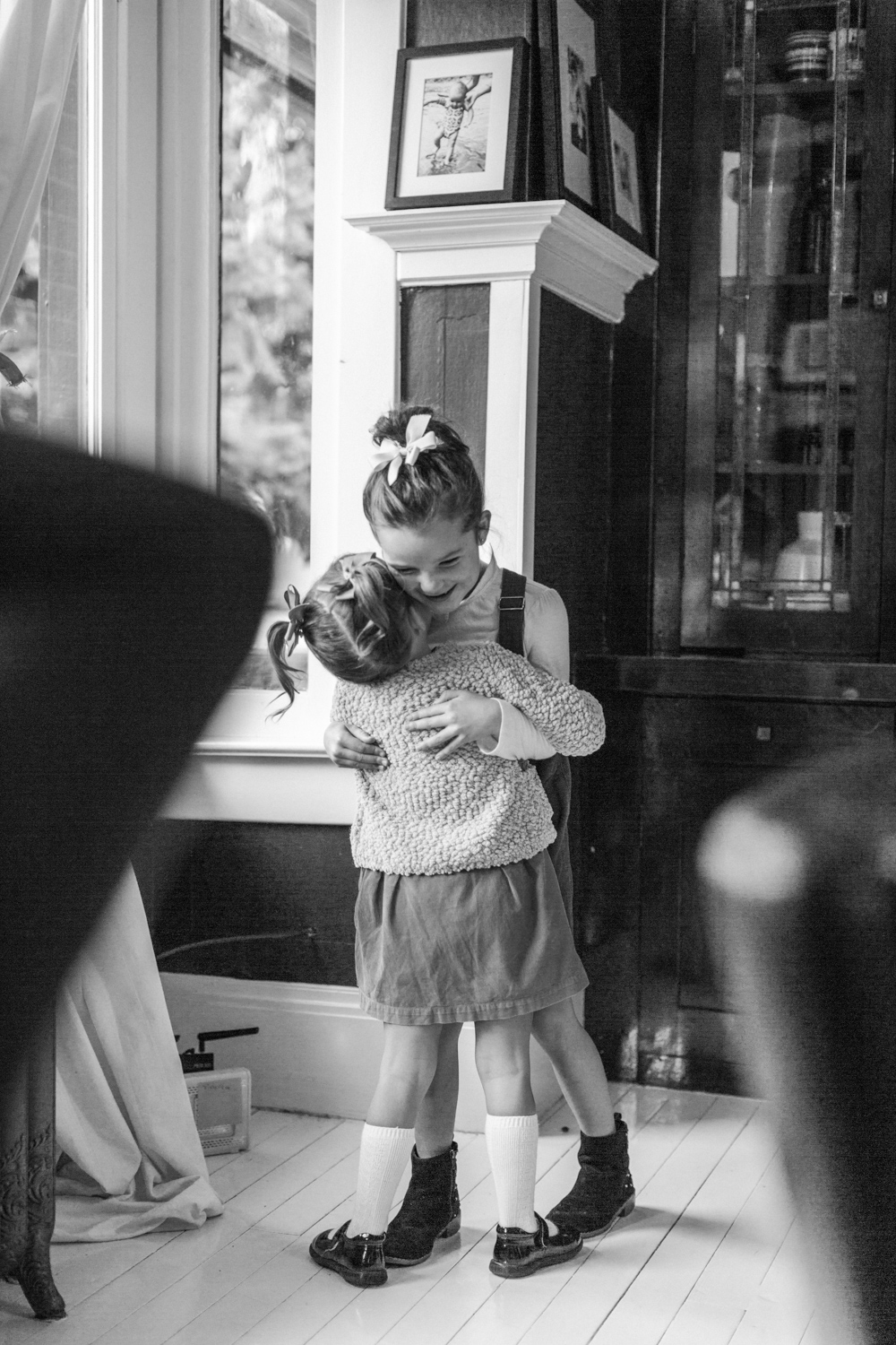 Two sisters hugging in an in home session in Los Angeles.