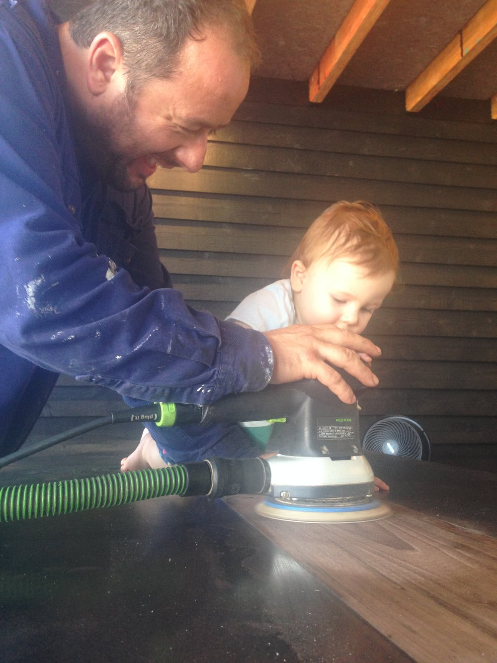 Artie helps his dad build the table.