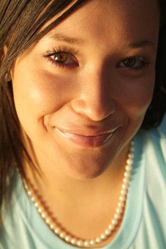 ny headshot sun smile.jpg